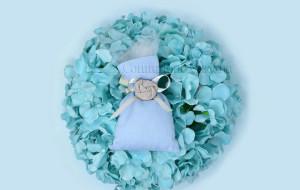Sacchetto azzurro in tessuto con fiocco ecrù in raso e rosellina - Collezione Shabby - €6,00